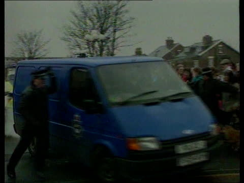 european court of human rights on jamie bulger killers lib preston police van carrying thompson and venables along past baying crowd and police... - lancashire stock videos and b-roll footage