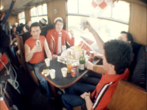 vídeos de stock e filmes b-roll de liverpool liverpool fans towards hat along rl in as cans of beer and crutches carried rl seated in carriage pan l singing 'we're going to wembley'... - liverpool inglaterra