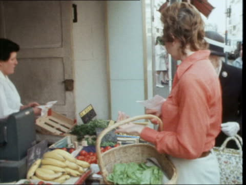 shopping in france france french flanders lille ext mrs janet bateman from shop with basket and french bread loaf police officers in street gvs mrs... - french food wine stock videos & royalty-free footage