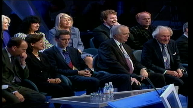 celebrity endorsement lib england dorset bournemouth davidson songwriter tim rice sitting with conservative party politicians on conference stage... - tim rice stock videos and b-roll footage