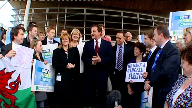 david cameron in wales wales cardiff national assembly ext david cameron mp walking down steps of national assembly building with kay swinburne... - politics and government stock videos & royalty-free footage