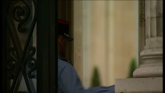 far right national front party win a quarter of vote france paris police officer along in front of gates pull focus european flag and french flag low... - national front stock videos and b-roll footage