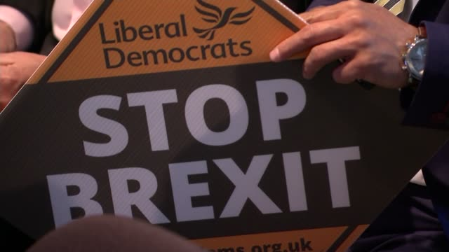liberal democrats launch campaign england london int liberal democrats 'stop brexit' sign held at launch of their campaign for the european elections... - sticker stock videos and b-roll footage