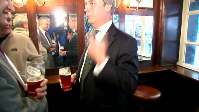 Nigel Farage photocall in pub ENGLAND London Westminster EXT Pub window ZOOM IN Nigel Farage MEP in pub Farage drinking pint and chatting / Farage...