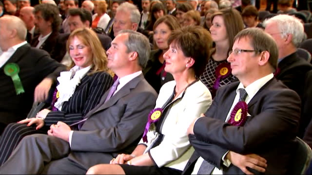 results england hampshire southampton leader nigel farage sat with other ukip candidates and supporters and cheering as the results for the european... - southampton hampshire stock-videos und b-roll-filmmaterial
