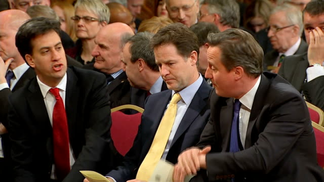 Results LIB / ENGLAND London Westminster INT Ed Miliband MP Nick Clegg MP and David Cameron MP chatting as sitting together in audience
