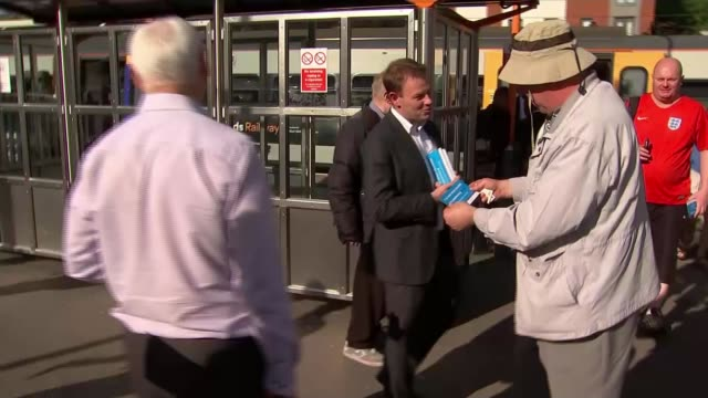 Support for Conservatives and Labour ebbs away ENGLAND Birmingham Sutton Coldfield EXT Various of Daniel Dalton handing out election leaflets to...