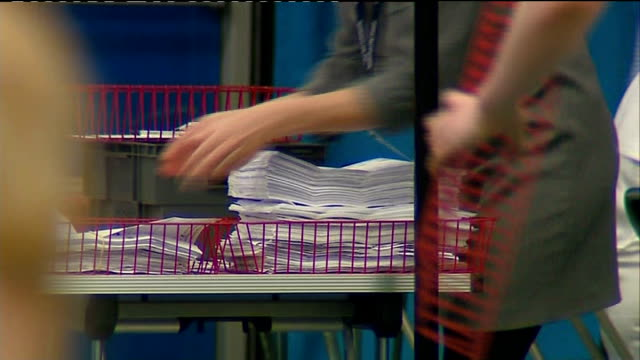 Vote counting in Sunderland ENGLAND Tyne and Wear Sunderland Sunderland Tennis Centre INT Various of people counting votes from European Elections...