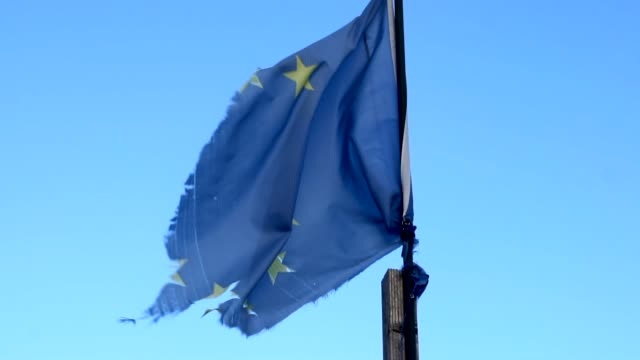 european flag wafting in slow motion. old, worn, broken - damaged stock videos & royalty-free footage