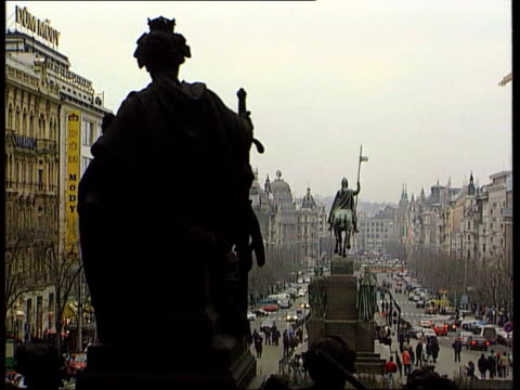 prague ext street with statues down centre and people and traffic along people along street hats displayed b/w clarinets played - woodwind instrument stock videos and b-roll footage