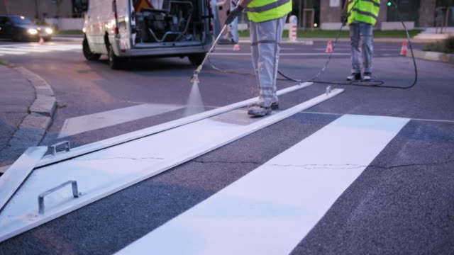european infrastructure crew repainting road markings - improvement stock videos & royalty-free footage