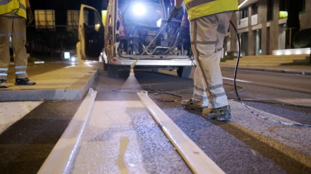european infrastructure crew repainting road markings - freshly painted stock videos & royalty-free footage