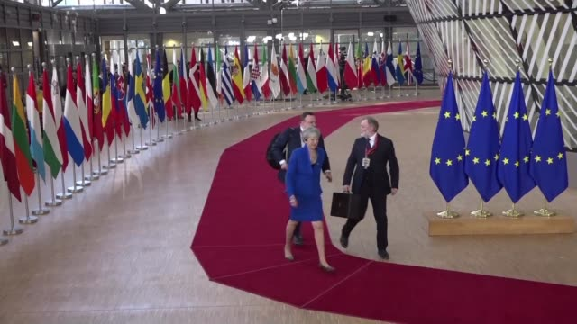 european leaders including british prime minister theresa may and german chancellor angela merkel arrive for the eu summit on brexit in brussels - angela merkel stock videos & royalty-free footage