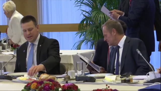 european leaders including theresa may sitting down for lunch at the eu summit in brussels - angela merkel stock videos & royalty-free footage