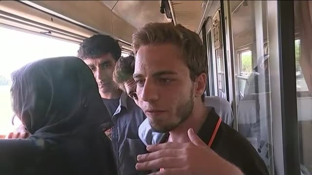 european migrant crisis: migrants travel through country by train in attempt to reach eu; point of view shot - povs - from rear of train as through... - grecia stato video stock e b–roll