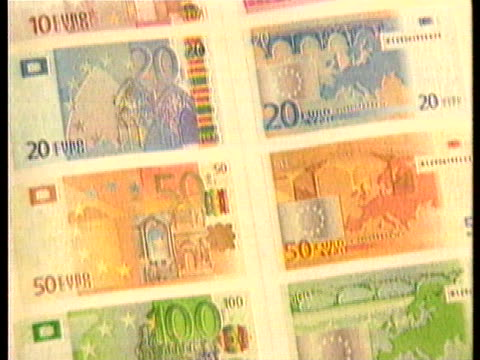 stockvideo's en b-roll-footage met european nations introduce the euro currency - (war or terrorism or election or government or illness or news event or speech or politics or politician or conflict or military or extreme weather or business or economy) and not usa
