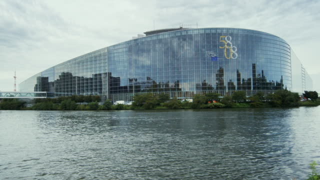 t/l, ms, european parliament building across marne-rhine canal, strasbourg, france - european union stock videos and b-roll footage