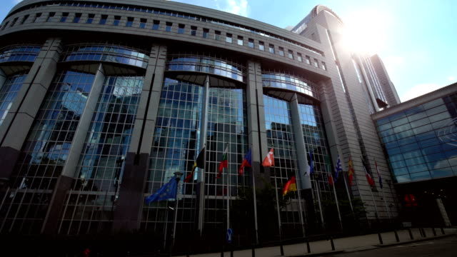 european parliament in brussels. german flag moved to the half. - government building stock videos and b-roll footage