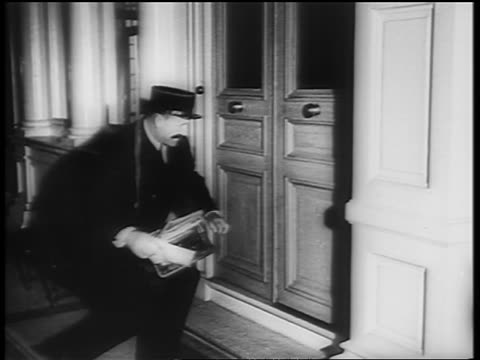b/w 1961 european postman dancing the twist as he delivers mail under door / newsreel - nur männer über 30 stock-videos und b-roll-filmmaterial