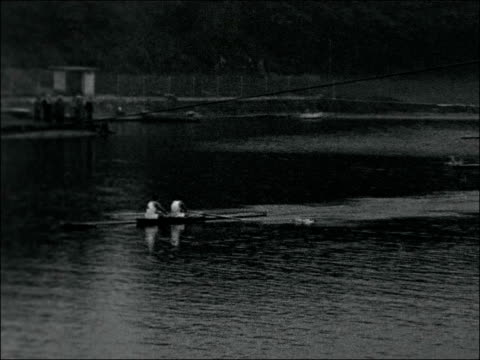 british coxless pair beaten west germany duisberg ext varous of men's coxless pairs heat chris davidge and tony leadley rowing in hear austria win... - canottaggio senza timoniere video stock e b–roll