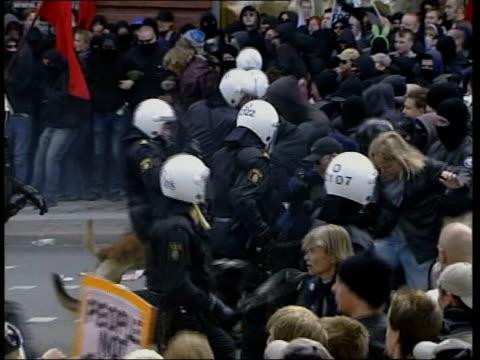 European Summit violence British man due in court LIB Gothenburg Anticapitalist protestors hurling rocks at riot police Riot police charging...