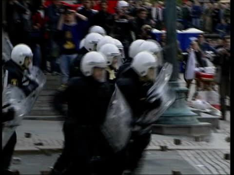 European Summit violence British man due in court SWEDEN Gothenburg Anticapitalist protestors hurling rocks at riot police Riot police charging...