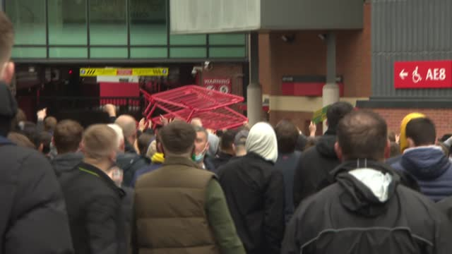 european super league: aftermath of manchester united protests; england: manchester: old trafford: ext various shots of manchester united fans... - europe stock videos & royalty-free footage