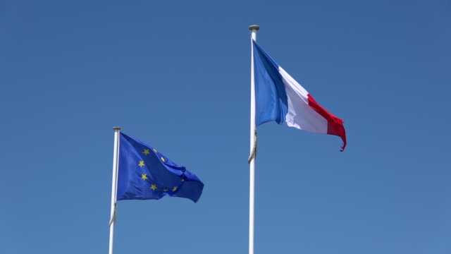 european union and french flag in wind - french culture stock videos & royalty-free footage