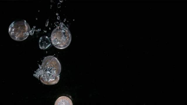 SLO MO European union coins falling into water