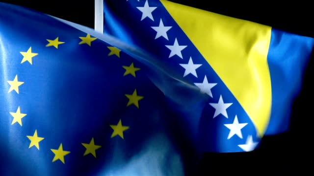 european union flag and bosnia and herzegovinan flag - genocide stock videos & royalty-free footage
