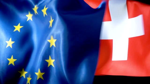 flagge der europäischen union und flagge der schweiz - politics stock-videos und b-roll-filmmaterial