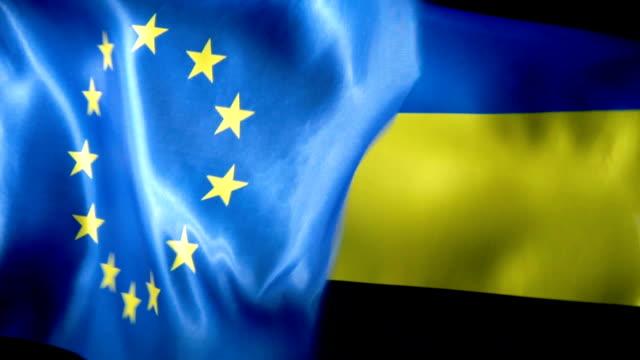 vídeos de stock e filmes b-roll de european union flag and ukrainian flag - ucrânia bandeira
