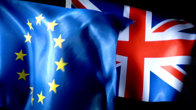 european union flag and united kingdom flag - bandiera del regno unito video stock e b–roll