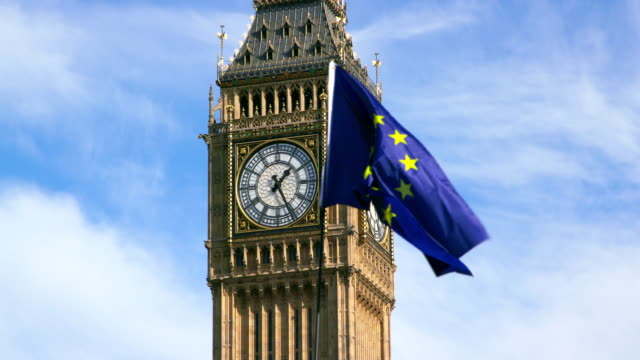 stockvideo's en b-roll-footage met european union flag & big ben parliament square  london - brexit