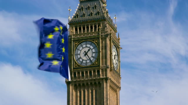 european union flag & big ben parliament square  london - brexit stock videos & royalty-free footage