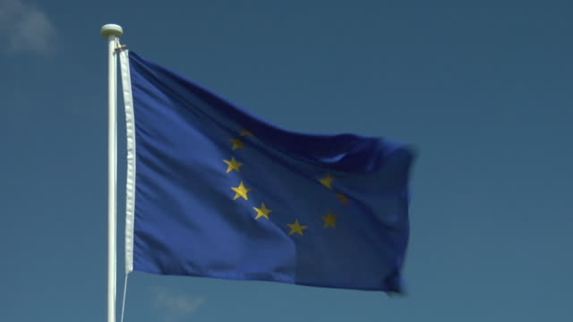 CU, European Union flag flapping against clear sky