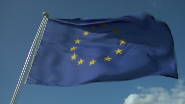 cu, la, european union flag flapping against clear sky - european union stock videos and b-roll footage