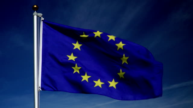 4K: European Union Flag on Flagpole in front of Blue Sky outdoors (EU)