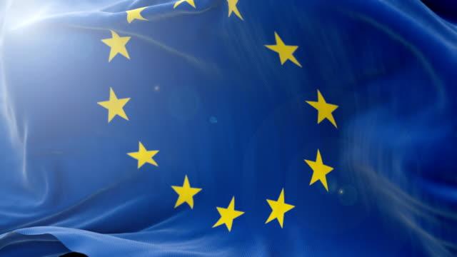 欧州連合旗遅いを振る背景。4 k は、旗を振るを閉じます。シームレスなループ - 欧州連合旗点の映像素材/bロール