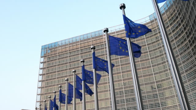 european union flags at berlaymont building - european commission building in brussels - europe stock videos & royalty-free footage