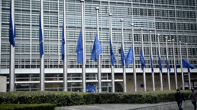 european union flags fly half-mast at the european union commission buiding in brussels on march 25, 2015 to mourn germanwings airbus a320 plane... - europäische union stock-videos und b-roll-filmmaterial