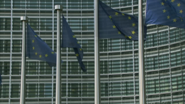 CU ZO WS European Union flags waving outside European Commission headquarters in Berlaymont building / Brussels, Belgium
