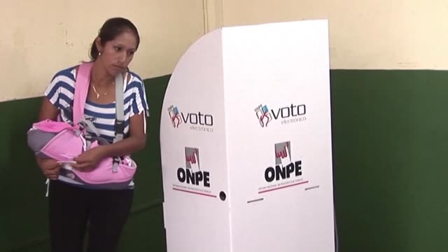 european union observers are on hand at some locations in lima to monitor the vote as peruvians cast their ballots in general elections - peruvian ethnicity stock videos & royalty-free footage