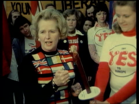 row over european constitution itn lib held millbank then cabinet minister margaret thatcher mp wearing jumper decorated with the flags of the... - referendum stock-videos und b-roll-filmmaterial