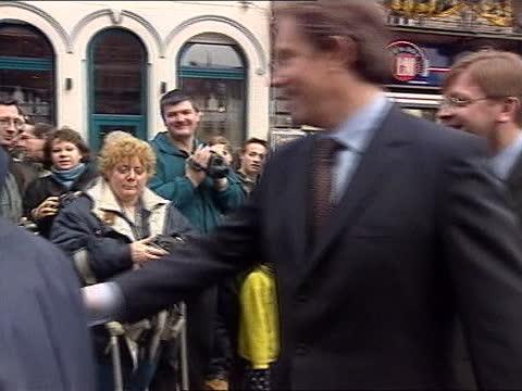 stockvideo's en b-roll-footage met tony blair speech; a)nn: robert moore belgium: ghent: ext tony blair mp on walkabout in town centre blair shaking hands of spectators - politics