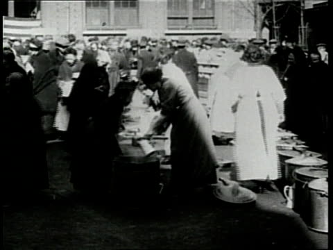 europeans and their families eat at an outdoor soup kitchen at the end of world war one - soup kitchen stock videos & royalty-free footage