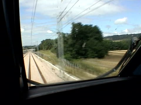 eurostar breaks speed record itn kent train driver pov as train emerges from channel tunnel into daylight ext train emerging from channel tunnel at... - eurostar stock-videos und b-roll-filmmaterial