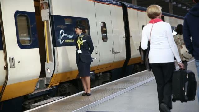 eurostar employees stand at the doorway of passenger train operated by eurostar international ltd at st pancras international railway station in... - eurostar stock-videos und b-roll-filmmaterial