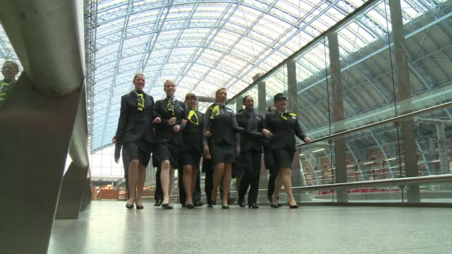 eurostar marked the start of its 20th anniversary year tuesday by unveiling an updated uniform for its staff the companys first new design in nearly... - eurostar stock-videos und b-roll-filmmaterial
