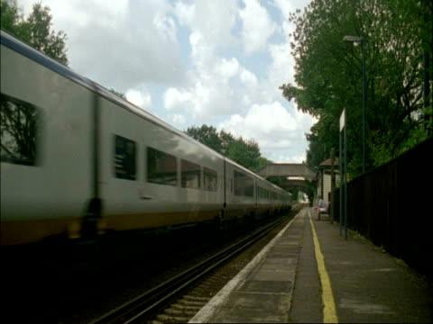 vídeos de stock, filmes e b-roll de ms eurostar (channel tunnel) train passes through station, pluckley, kent - 2005